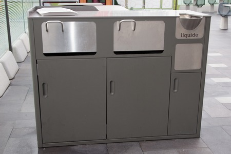 public waste: Trash bins to separate waste in a public building, copy-space
