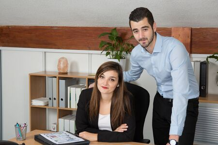 service desk: Customer and female financial agent in a discussion at desk. Stock Photo