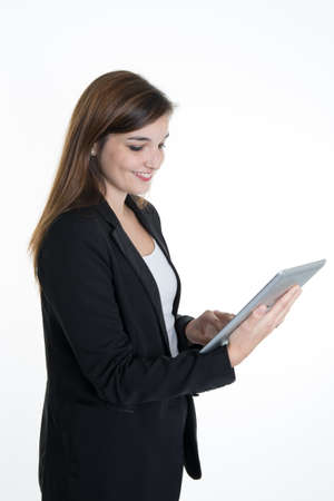 Happy business woman using tablet pc isolated