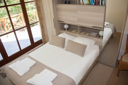 bedspread: Double Bed In The Bedroom With Desk Lamp