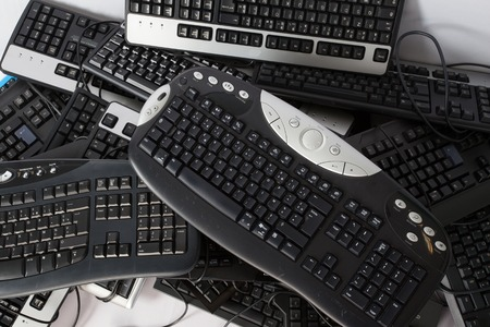 obsolete: Old, used and obsolete electronic keyboards, stack of keyboards