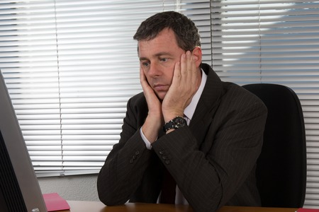 afflict: mature businessman visibly bored and disappointed