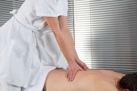 shiatsu: Man having Shiatsu massage on his back by therapist