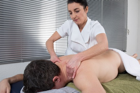 hand rubbing: Middle aged man getting a massage at Spa center Stock Photo