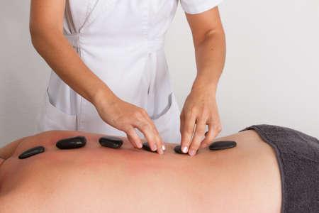 hot stone: Man is having a hot stone massage