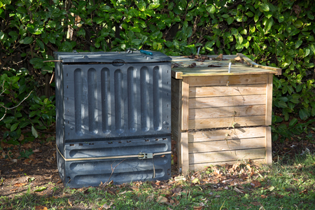 rotting: Compost bin in garden - full of grass and rotting fruit or vegetables