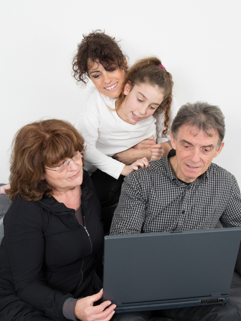 grand daughter: Senior people with daughter and grand daughter doing shopping online