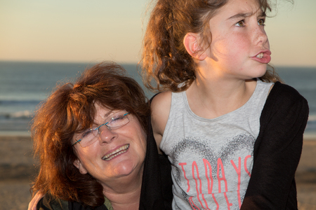 grand daughter: Grandmother with the grand daughter at the beach on summer