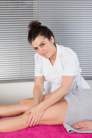 hamstrings: Close up Detail of Hands massaging female hamstrings. Therapist doing manipulative treatment on upper back leg.
