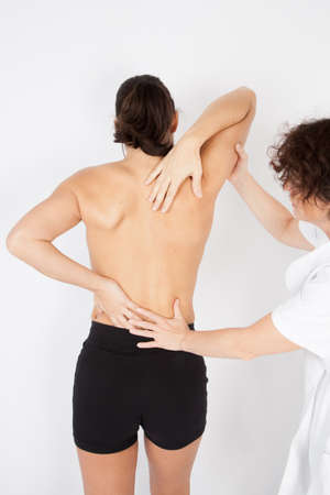chiropractic: Chiropractic: Chiropractor female examining a young woman Stock Photo