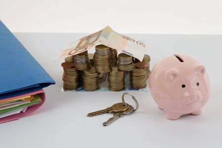 hoard: Piggy bank style money box, folders with key isolated on a white