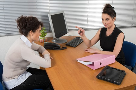 buisness: Serious buisness woman during a business appointment