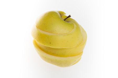 sliced apple: Yellow Sliced Apple, isolated on a white background
