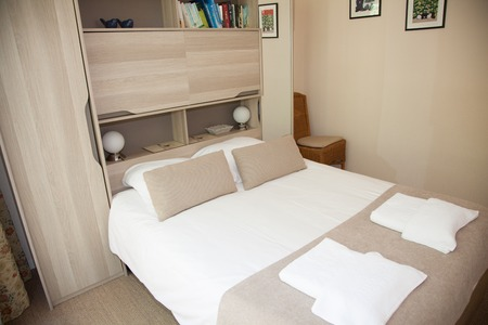 bedside lamps: Double Bed In The Bedroom With Desk Lamp Near It