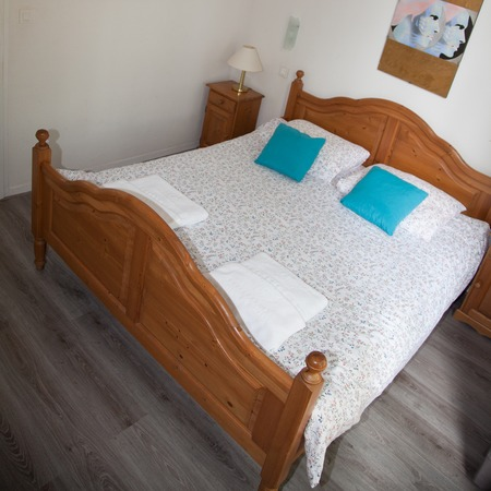 bedspread: Double Bed In The Bedroom With Desk Lamp Near It