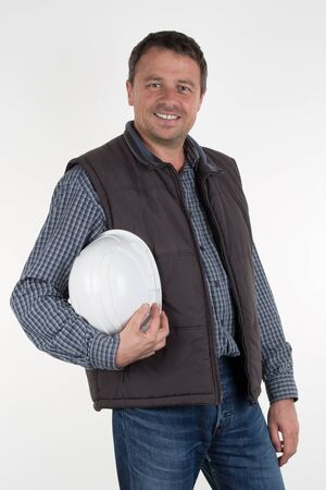 foreman: Picture of a happy young foreman with hard hat Stock Photo