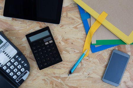 drafting tools: To view of drafting tools, laptop, phone, and calculator isolated on wooden background Stock Photo