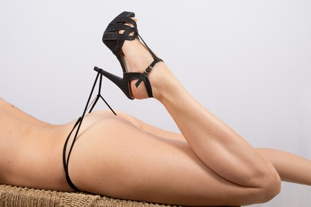 female buttocks: Sexy female buttocks and legs in high heel black shoes