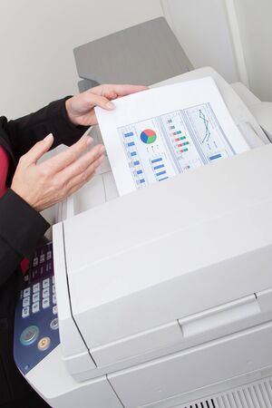 hp: Close-up of a Businesswoman with printing graph paper and printer isolated