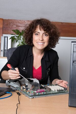 harddisc: Female support computer engineer - woman repair defect Stock Photo