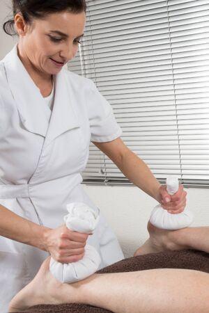 restore energy flow: Reflexology foot massage, spa foot treatment,Thailand Stock Photo