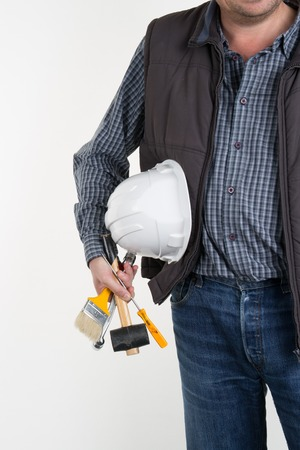 jovial: Craftsman with tools and hand drill isolated on a white background