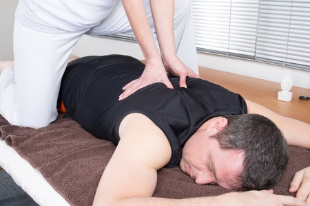 stiffness: Patient at the physiotherapy gets massage or lymphatic drainage Stock Photo