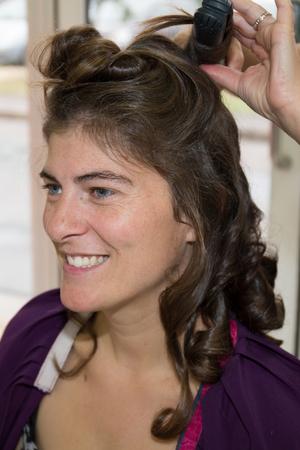 hair stylist: Hair stylist makes the bride on the wedding day
