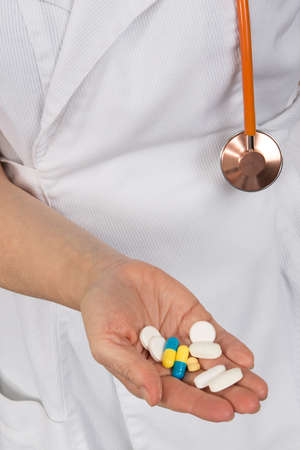 hand holding pills: Close-up of woman doctor hand holding pills Stock Photo