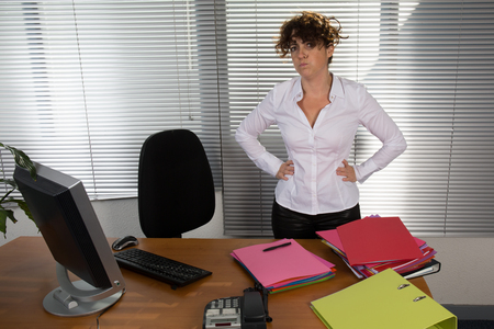 ultrabook: Business woman working with documents in office.