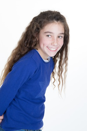 9 year old girl: Glad little girl looking at camera and smiling. studio shot over white background