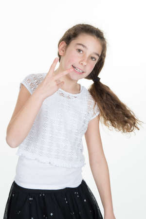 ok: Young girl showing her hand gesture victory isolated Stock Photo
