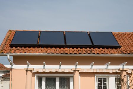 A Rooftop solar panels on a modern house Stock Photo