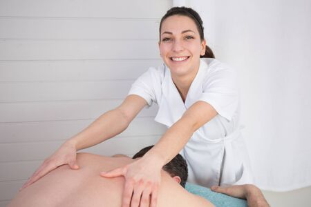 female therapist: Close-up of female therapist doing medical massage