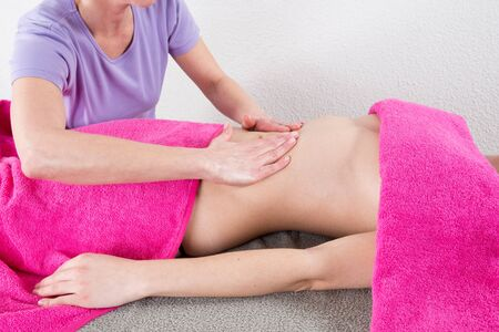 receives: The woman who receives body stomach massage at spa center