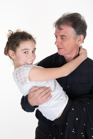 relatives: Family portrait of a grandfather and his granddaughter. Loving relatives indoor Stock Photo
