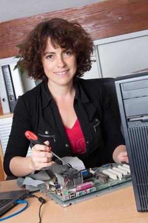 harddisc: Female support computer engineer - IT woman repair defect computer