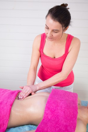 visceral: Picture of Osteopathic belly massage given by a female therapist