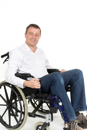 Portrait of middle age man in wheelchair. Isolated on white