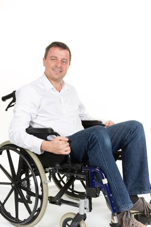 paraplegic: Retrato de hombre de mediana edad en silla de ruedas. Aislado en blanco Foto de archivo