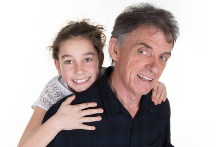 girl and her father having fun, shot over white in studio Imagens