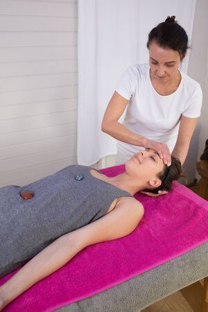 masticate: Young woman relaxing during bioenergy therapy session