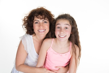 hispanic kids: Mother and daughter smiling isolated over a white background