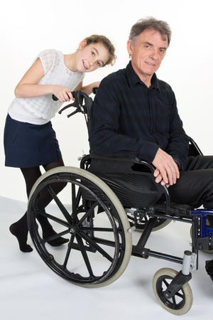 grand daughter: Girl is friendly and shoves man in wheelchair