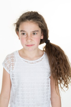 is disgusted: Disgusted and frowning young girl on a white background