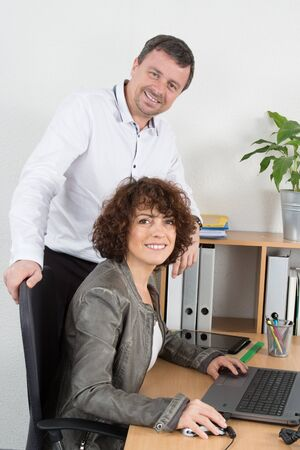 parity: Two business partner working together in office parity