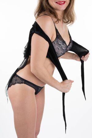 reggicalze: Bella donna in lingerie nera rivelatrice Archivio Fotografico
