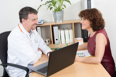 sales rep: Happy medical rep in a meeting with a confident doctor