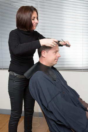 hair clippers: Close up of a male having a haircut with hair clippers