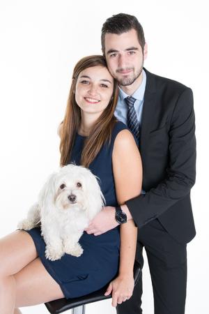 eyes hazel: Couple cuddling dog loving family  isolated Stock Photo